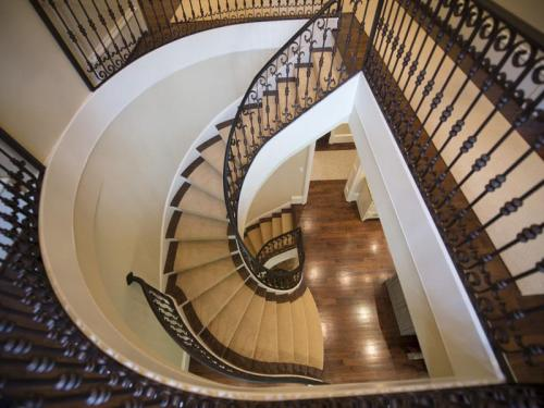 The staircase will take your breath away, and just one of many fine architectural details you will find throughout this exquisite property.