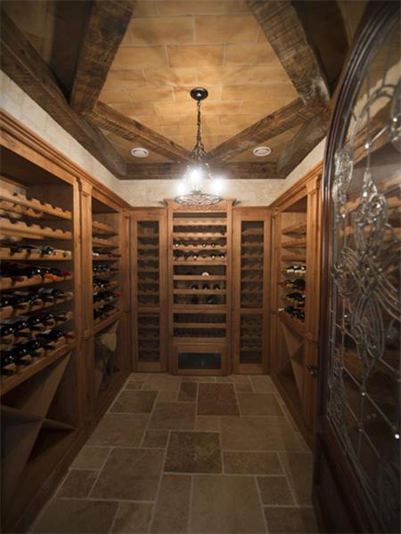 The custom designed wine cellar features an arched doorway, climate control and room for hundreds of your favorite bottles of wine.