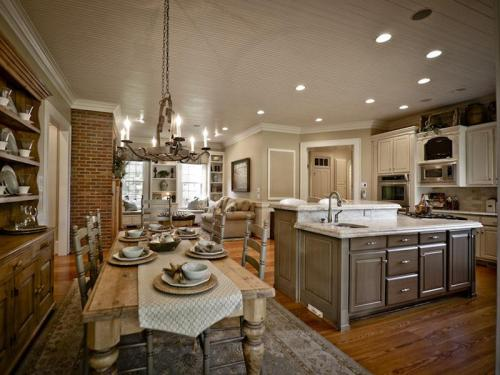 Inside, the main kitchen is the heart of the home and is open to the family room and breakfast area.