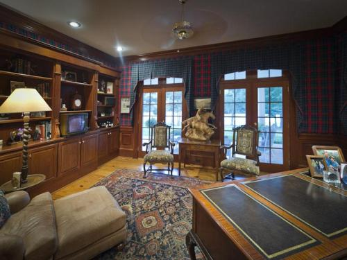 The stately study awaits a new owner.